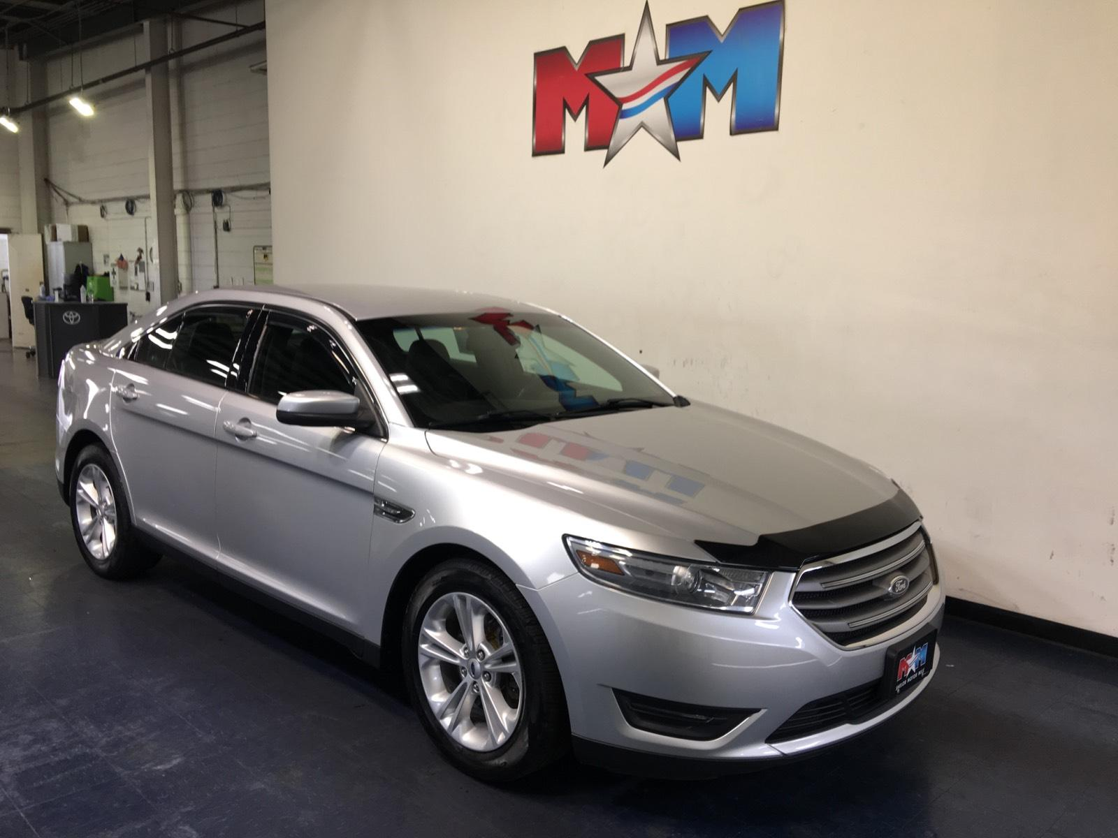Pre-Owned 2014 Ford Taurus 4dr Sdn SEL AWD
